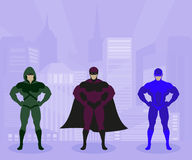 Strong men in costumes protect city Royalty Free Stock Photography