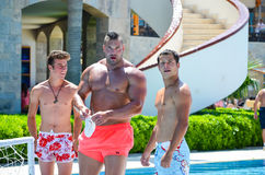 Strong men at pool Royalty Free Stock Photos