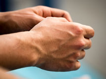 Strong men`s arms with veins. A photo Stock Image