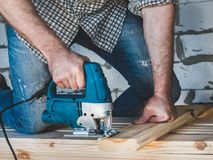 Strong men`s hands and tools stock image