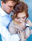 Strong men`s hugs. Real love hands Love Story in big city stock images