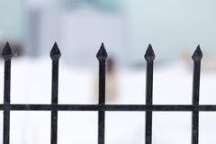 Strong metal fence with blured winter background Stock Images