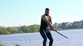 Strong movies with sword by master on the coast. Slowly stock video