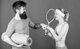 Strong muscles and body. Happy woman and bearded man workout in gym. Sporty couple training with fitness mat and tennis stock photo