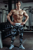 Strong muscular bodybuilder doing exercise in the gym. Part of fitness body. Royalty Free Stock Photography