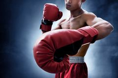 Strong muscular boxer on smoke background. S royalty free stock photos