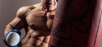 Strong muscular boxer in training. The athlete boxing Stock Photography