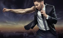 Strong and muscular businessman over the city Royalty Free Stock Photography