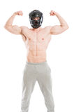 Strong and muscular fighter flexing arms Royalty Free Stock Photos