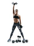 Strong muscular girl doing exercises with heavys dumbbells. royalty free stock photography
