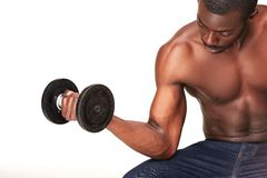 Strong and muscular guy with dumbbell isolated on Stock Photography