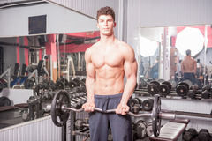 Strong muscular guy in the gym Royalty Free Stock Photography