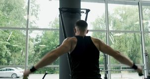 Strong Muscular male working on skis simulator. Cross Fitness Training in the gym.  stock video footage