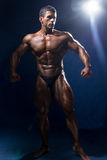 Strong muscular man bodybuilder in full growth. Royalty Free Stock Image
