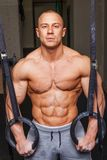 Strong muscular man. Bodybuilder poses and shows his body Stock Images
