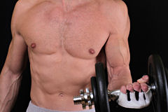 Strong muscular man  man exercising with dumbbell Royalty Free Stock Photography