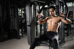 Strong muscular man preparing for workout in crossfit gym. Young athlete practicing cross-fit training stock image