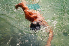 Strong muscular man swimming in the sea ocean srawl style. Active summer holiday vacation. Sport, healthy lifestyle concept Stock Images