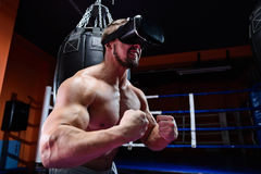 Strong muscular man wearing virtual reality glasses Stock Image