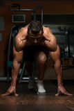 Strong Muscular Men Kneeling On The Floor Royalty Free Stock Photo