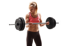Strong muscular woman exercising with a barbell Royalty Free Stock Photo
