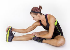 Free Strong Muscular Woman Stretching Before Workout On White Background Royalty Free Stock Photo - 53150275