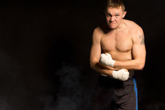 Strong muscular young boxer Royalty Free Stock Photo