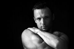 Strong muscular young Caucasian man portrait Stock Photos