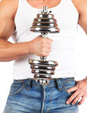 Strong muscullar man holding chromed dumbbell Royalty Free Stock Images