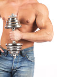 Strong muscullar man holding chromed dumbbell Royalty Free Stock Image