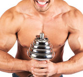 Strong muscullar man holding chromed dumbbell Royalty Free Stock Photos