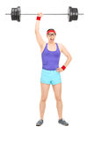 Strong nerdy athlete holding a heavy weight. Full length portrait of a strong nerdy athlete holding a heavy weight in one hand isolated on white background Royalty Free Stock Images