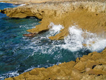 Strong Ocean Waves Hitting the Shoreline in Greece Royalty Free Stock Photo