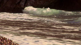 Strong ocean waves on a pebbly beach stock video footage