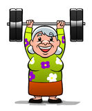 Strong old lady. Lifting a weight. She is happy and healthy Royalty Free Stock Images