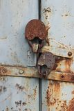 Two old reliable locks at gate of the barn Stock Image
