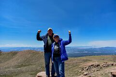 Strong Old Married Couple Enjoying The Top Of Pike`s Peak Royalty Free Stock Photography