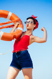Strong Pin-up. Beautiful Strong Pin-up at beach royalty free stock photos