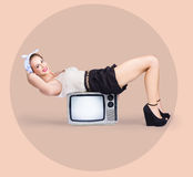 Strong pinup girl doing fitness exercises Royalty Free Stock Photography