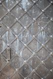 Strong plated medieval door, texture Royalty Free Stock Images