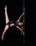 Strong pole dance woman in costume Royalty Free Stock Photography