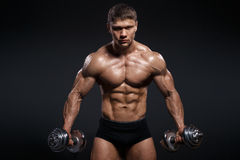 Strong and power bodybuilder doing exercises with dumbbell Stock Photos