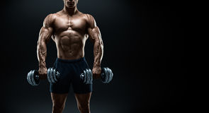 Strong and power bodybuilder doing exercises with dumbbells stock photos