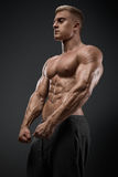Strong and power bodybuilder posing royalty free stock image