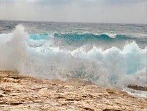 Strong powerful wave in Adriattic sea crashing Croatian beach at spring morning. Big waves splashing Croatian islands shore with horizon line in background royalty free stock photo