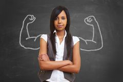 Strong and powerful woman. With self confidence and chalk muscles stock photos
