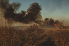 Strong prairie fire with large clouds of choking smoke erupted in southern steppe. Stock Images