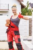 Strong woman building using bricks royalty free stock photos