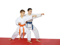 Strong punch hand in the performance of athletes with a blue belt and orange belt Royalty Free Stock Photo