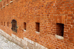 A strong red brick wall surrounding an ancient castle or antique fortress as fortification royalty free stock photo